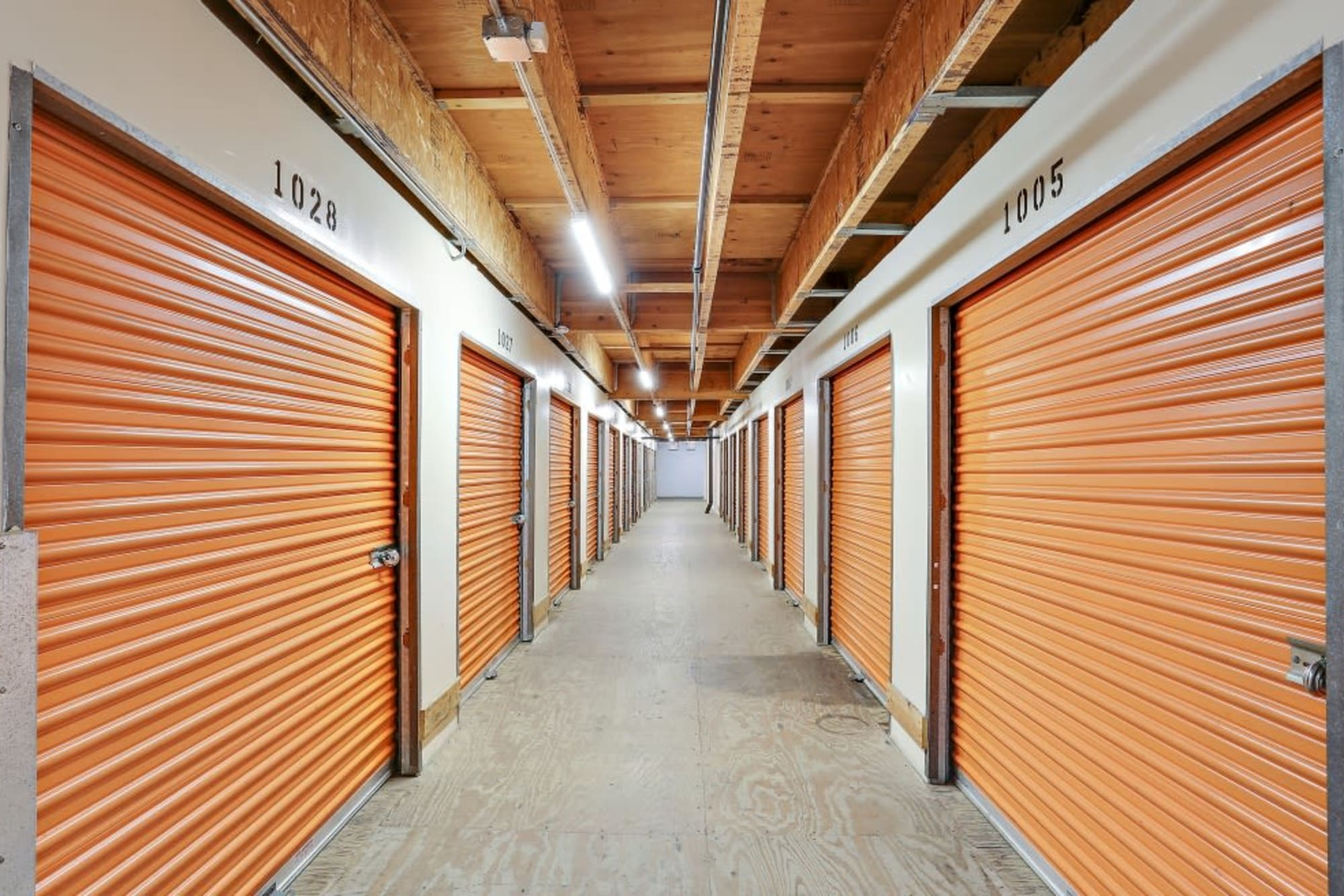A hall full of various storage unit sizes at A-1 Self Storage in Oceanside, California