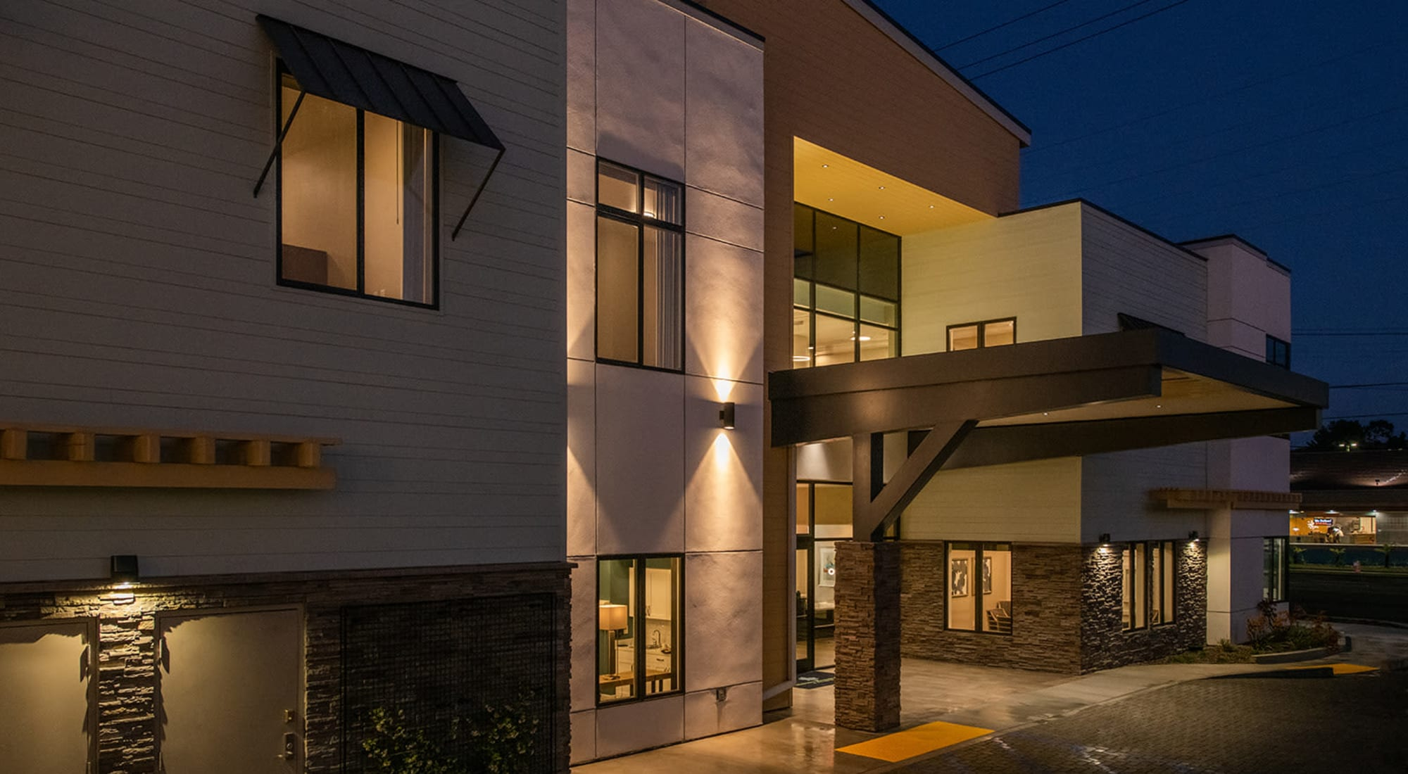 Nighttime exterior view of Seasons Memory Care at Rolling Hills in Torrance, California