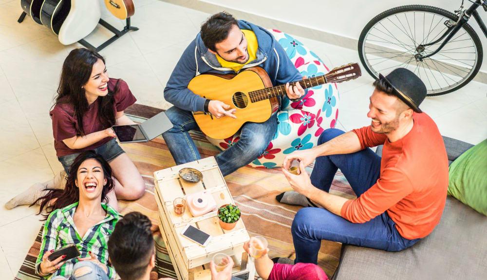 Friends having a picnic together at evolve Tuscaloosa in Tuscaloosa, Alabama