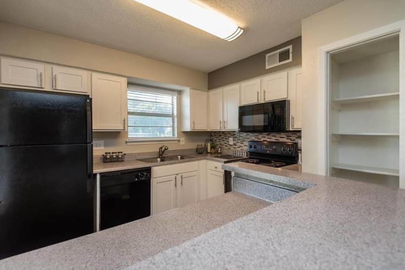 Kitchen area with tons of counter space in new ready to move into home at The Carling on Frankford in Carrollton, Texas
