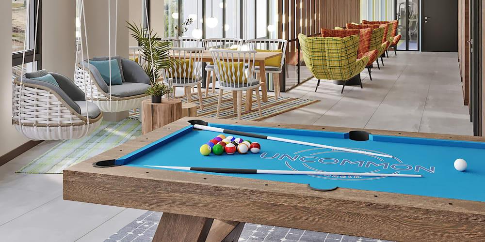 Community clubhouse with a billiards table at UNCOMMON Reno in Reno, Nevada