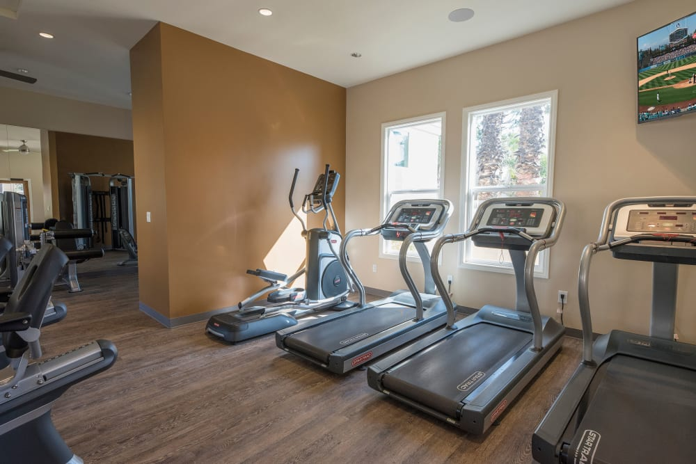 Fitness center with individual workout stations at Shadow Ridge Apartment Homes in Simi Valley, California
