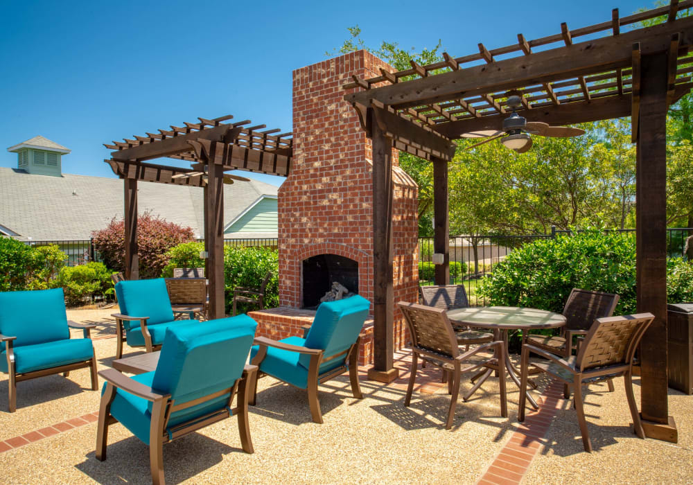 Lounging area outdoors on a sunny day at Sunstone Village in Denton, Texas