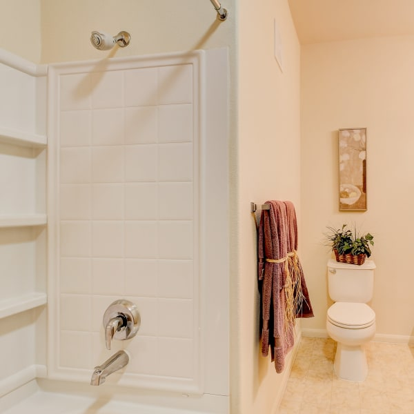 Bathroom with an oval tub at Laguna Creek Apartments in Elk Grove, California