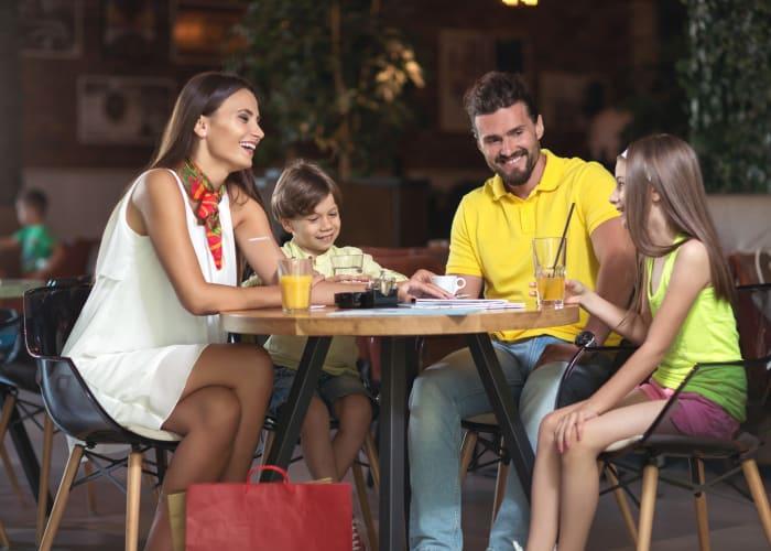 Family having dinner near City Center Apartments in Reno, Nevada