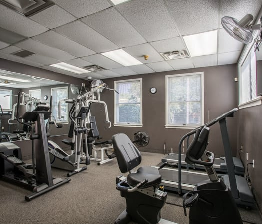 Fully equipped fitness center at Perinton Manor Apartments in Fairport, New York
