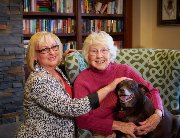Resident and her dog, chatting with resident's daughter at Burr Ridge Senior Living
