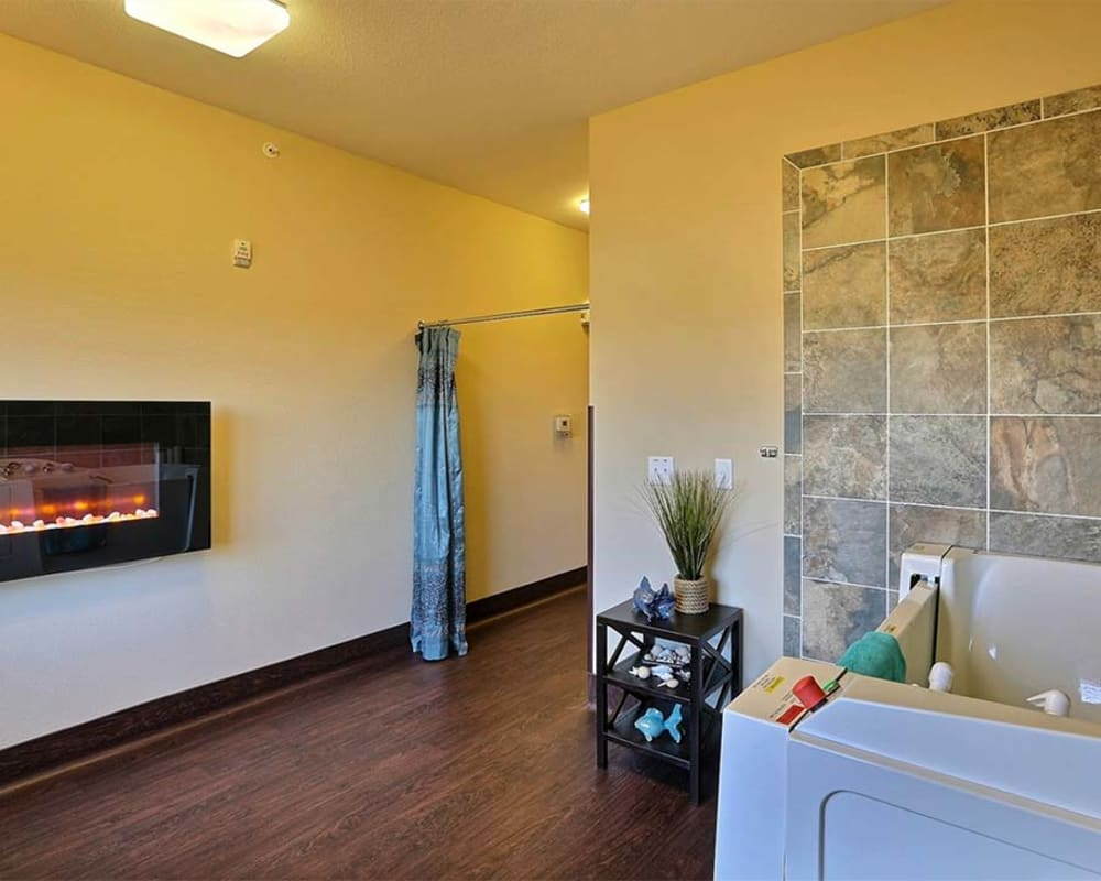 Resident spa with walk-in Jacuzzi tub at Milestone Senior Living in Cross Plains, Wisconsin.