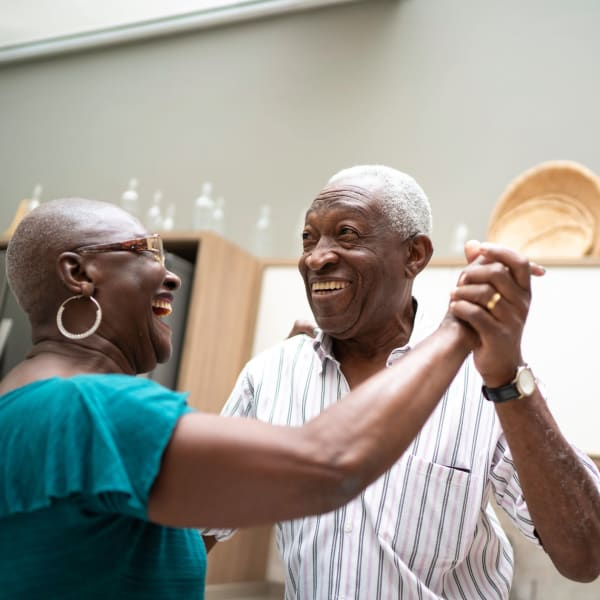 Two residents dancing at The Crest at Citrus Heights in Citrus Heights, California.