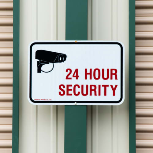 A sign for 24 hour security at Red Dot Storage in Antioch, Illinois