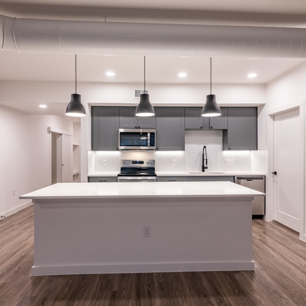 Large open kitchen with ample counter space and stainless steel appliances at The Langford in Dallas, Texas