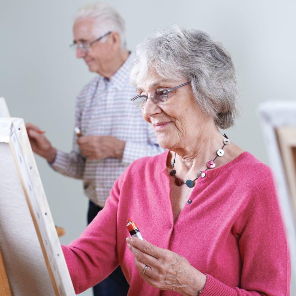 Residents painting at Anthology Senior Living in Denver, Colorado
