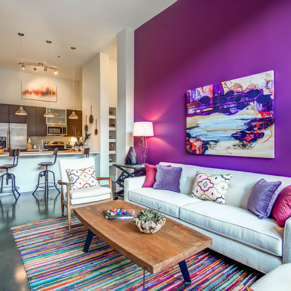 Awesome purple living room at Mercury NoDa in Charlotte, North Carolina