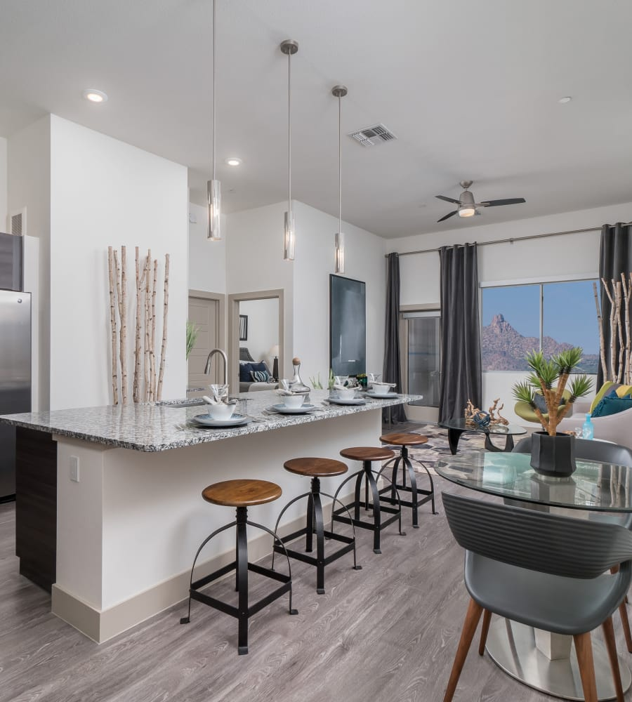 Modern kitchen with granite counter tops at The District at Scottsdale in Scottsdale, Arizona