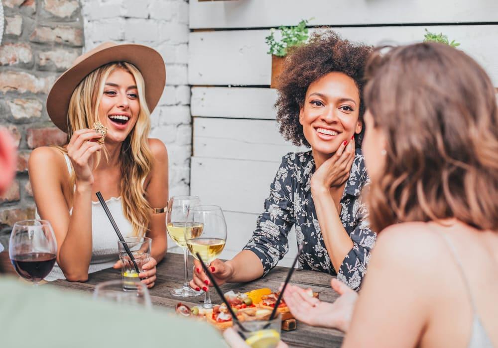 Resident friends having a drink near Sofi Belmont Hills in Belmont, California