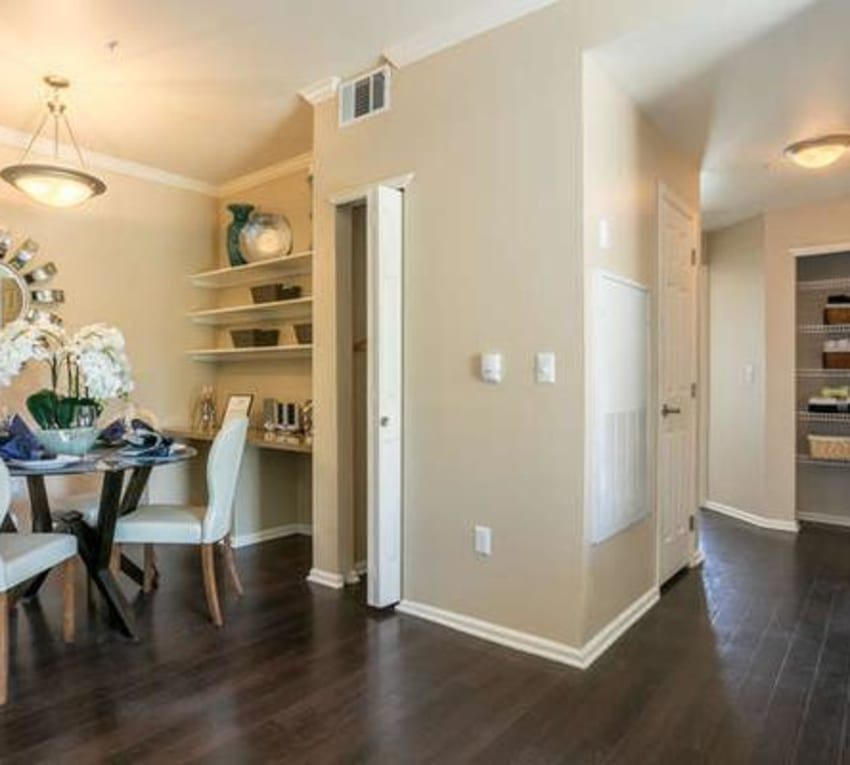 Dining table and hallway view of model at Westridge Apartments in Aurora, CO