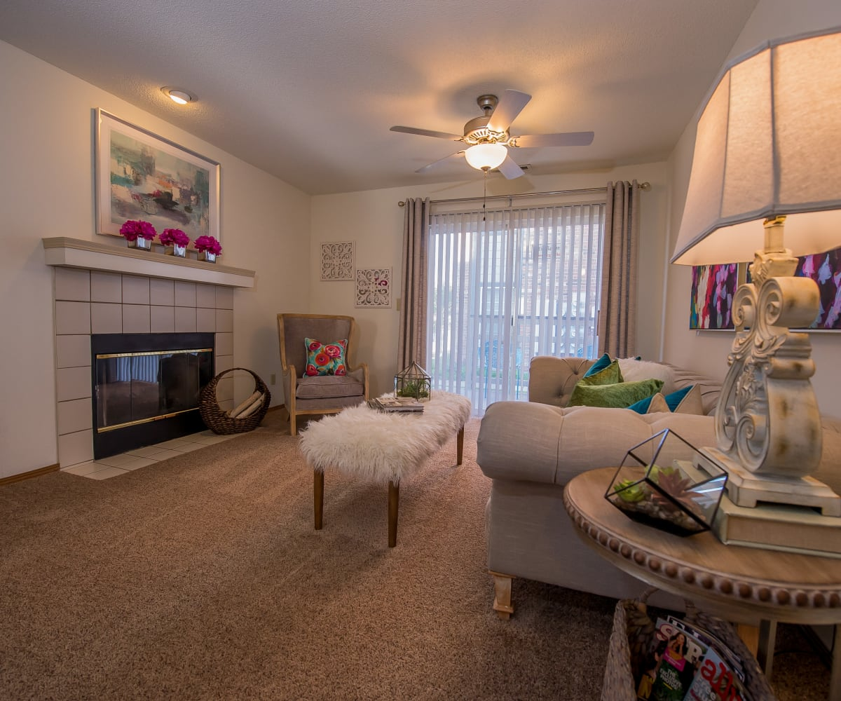Well-lit living room at Huntington Park Apartments in Wichita, Kansas