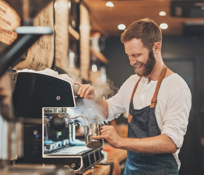 Barista making cappuccino near 6 West Apartments in Edwards, Colorado