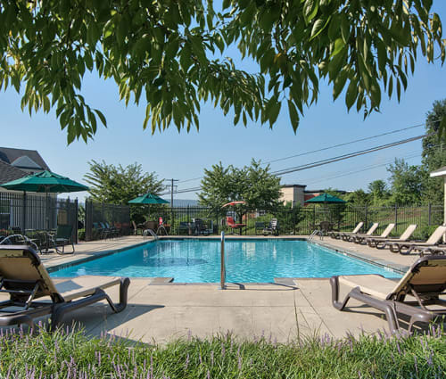 Resort-style swimming pool at Emerald Pointe Townhomes in Harrisburg, Pennsylvania