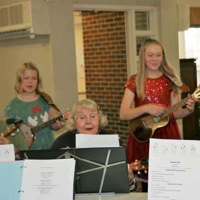 Residents and children playing music at Ebenezer Ridges Campus in Burnsville, Minnesota