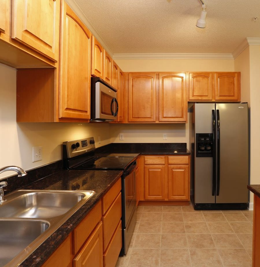 Kitchen with refrigerator at Waterford Place in Greenville, North Carolina