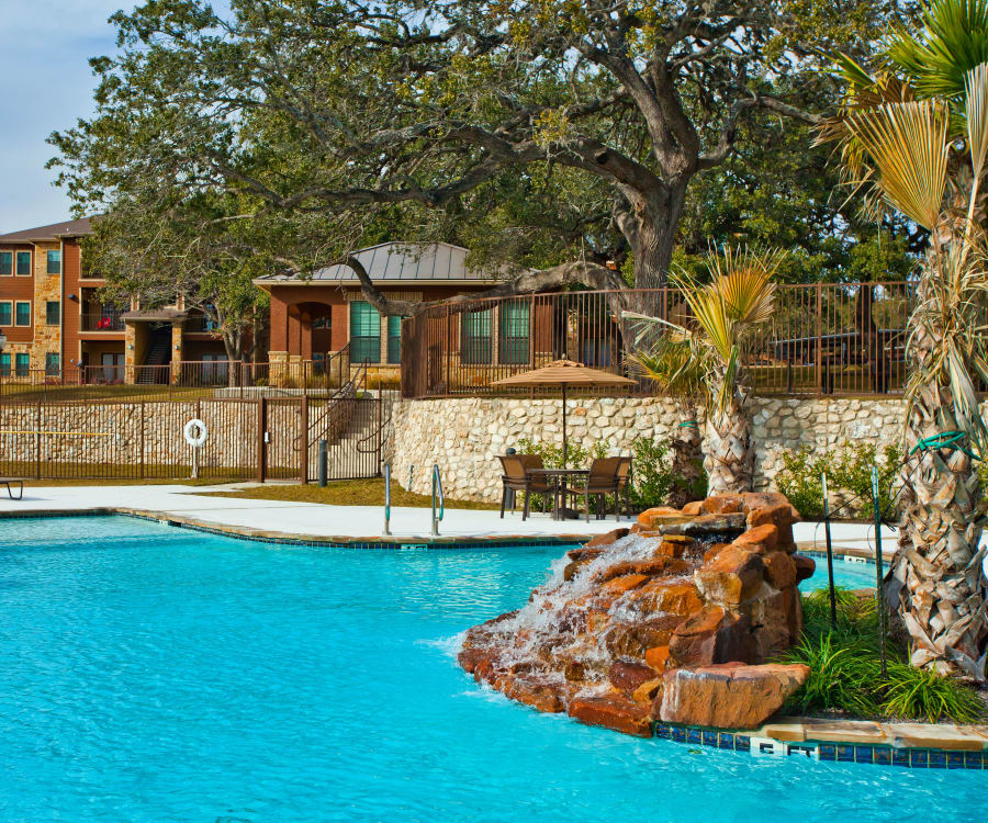 Swimming pool with island at The Hills at Fair Oaks in Fair Oaks Ranch, Texas