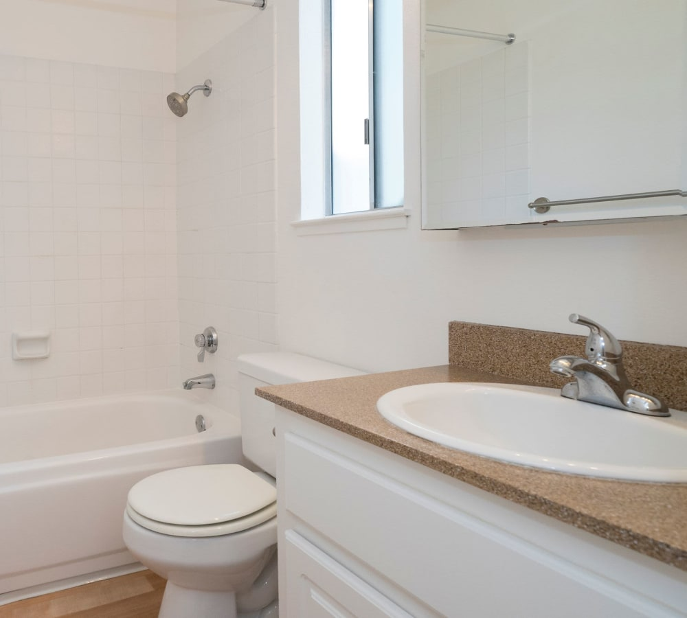 Bathroom with an oval tub at Valley Ridge Apartment Homes in Martinez, California