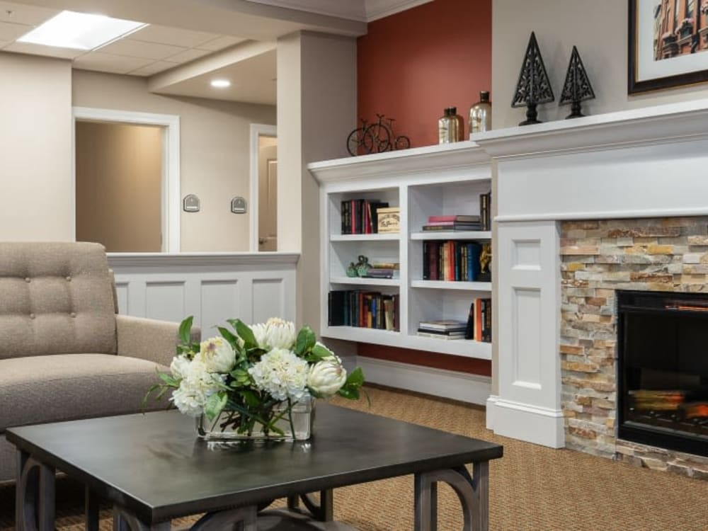 Community lounge with a fireplace at Randall Residence of Centerville in Centerville, Ohio