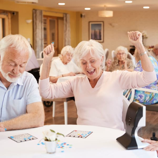 Resident playing bingo at The Crest at Citrus Heights in Citrus Heights, California