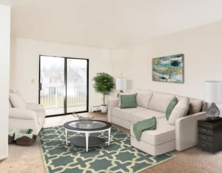 Bright, well decorated living room at Penbrooke Meadows in Penfield, New York