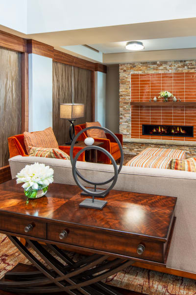 Upscale lounge with a fireplace at Quail Park of Oro Valley in Oro Valley, Arizona