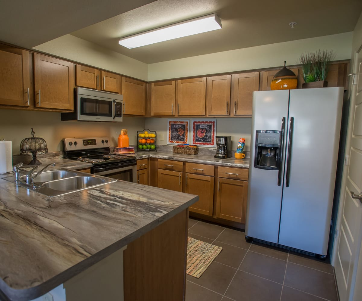 Kitchen with stainless steel appliances at The Reserve at Elm in Jenks, Oklahoma