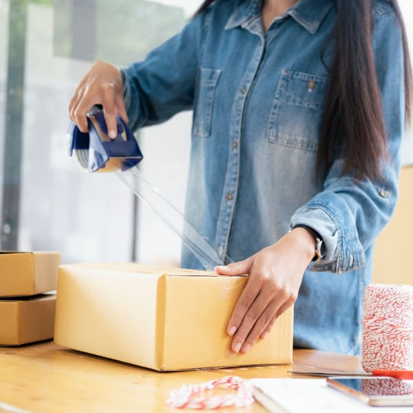A woman uses packing supplies available at Missouri Flat Storage Depot in Placerville, California