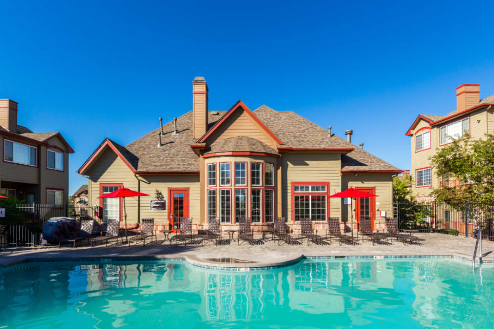 Resort style pool with scenic golf course and mountain views at The Links at Plum Creek in Castle Rock, Colorado