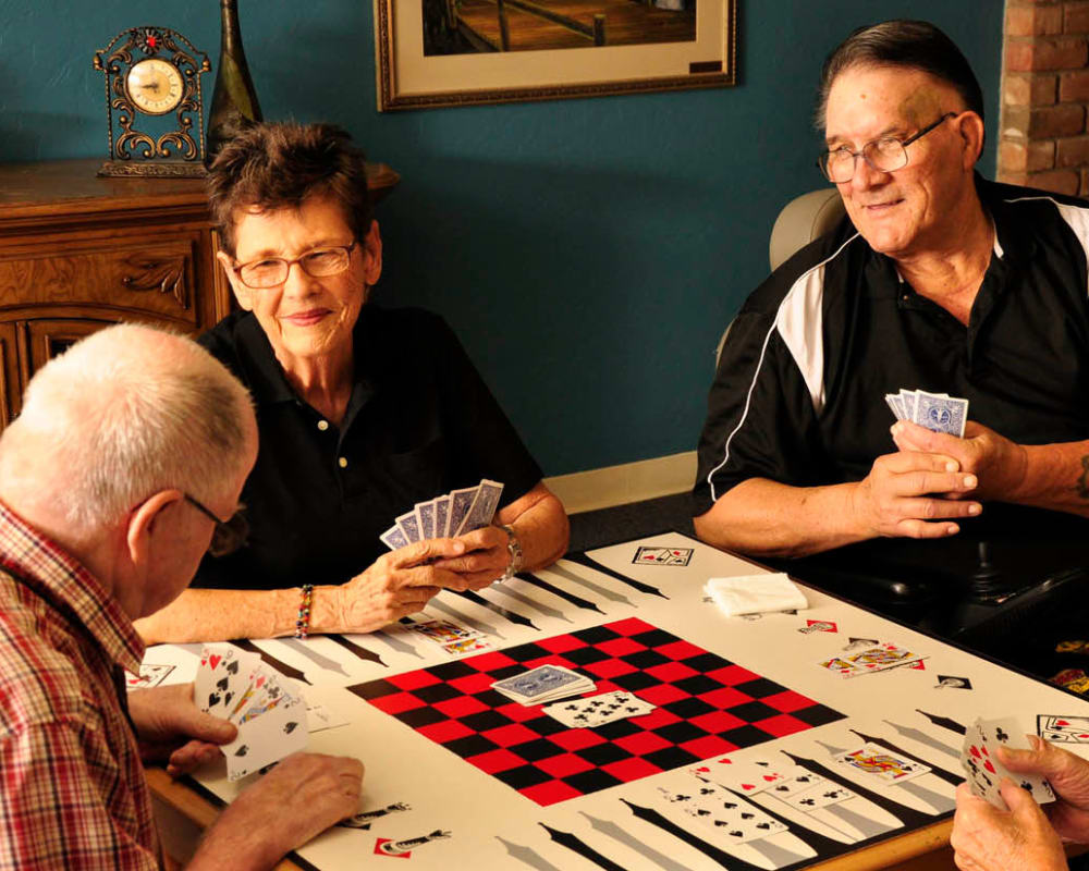 Seniors playing card games at Villa Maria Care Center in Tucson, Arizona