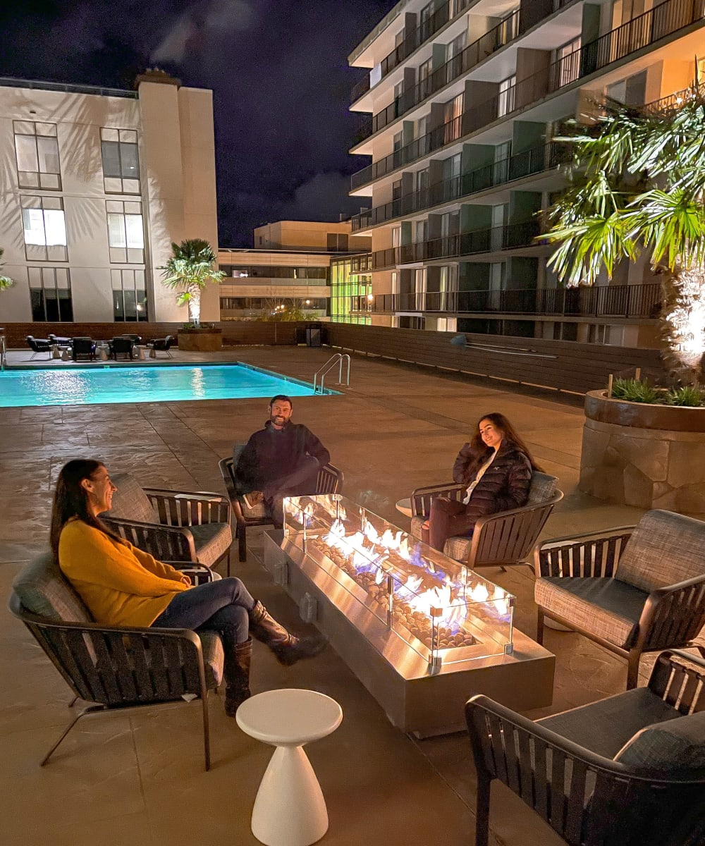Outdoor lounge and fitness area at Hillsborough Plaza Apartments in San Mateo, California