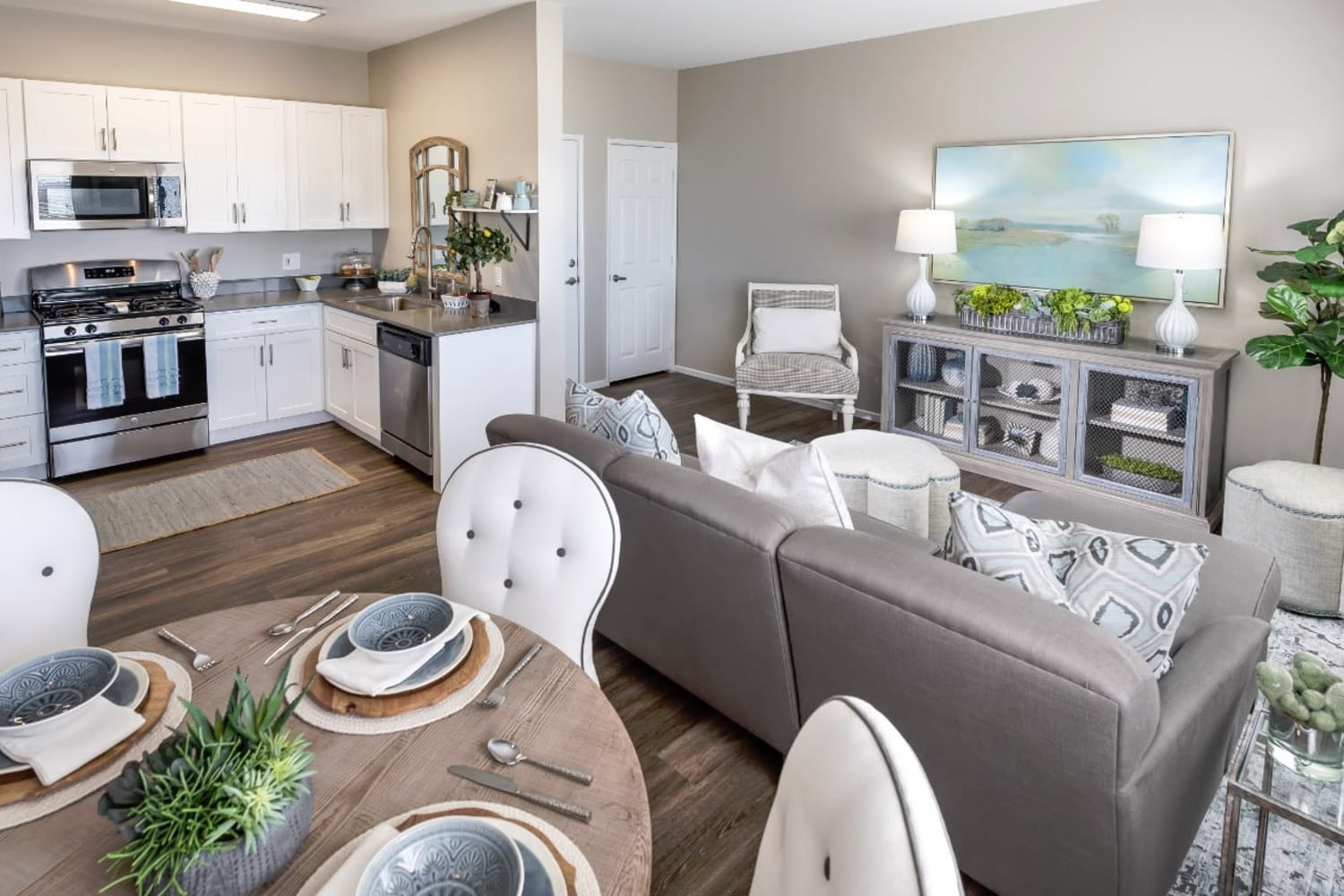 Well appointed kitchen, dining room and living room at Madrid Apartments in Mission Viejo, California