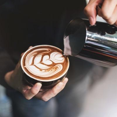 Barista preparing a latte at Terra Apartment Homes in Federal Way, Washington