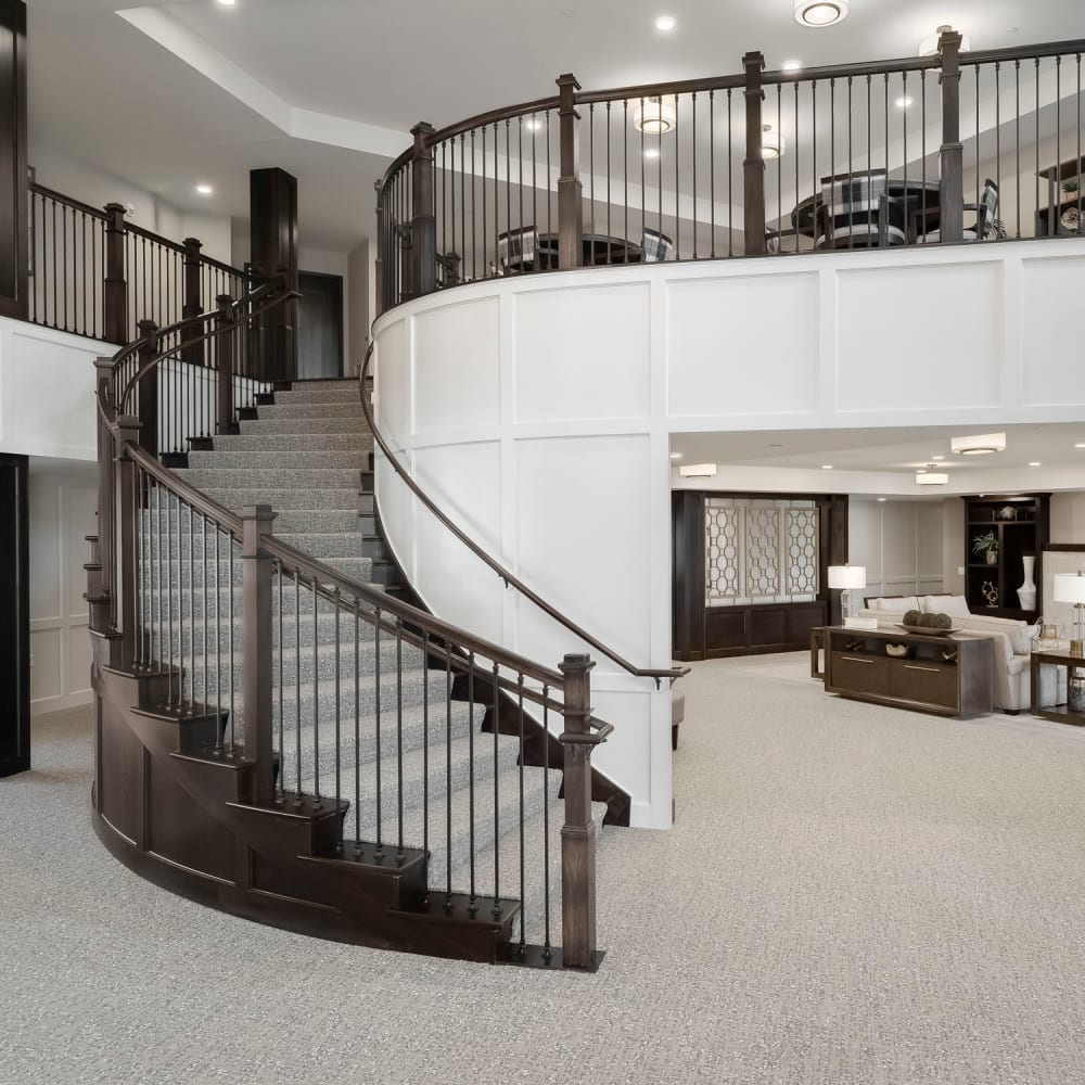 Lobby staircase at Applewood Pointe of Westminster in Westminster, Colorado.