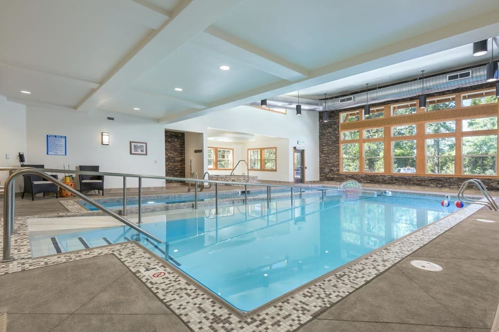 Indoor pool area with senior accommodation at The Springs at Greer Gardens in Eugene, Oregon