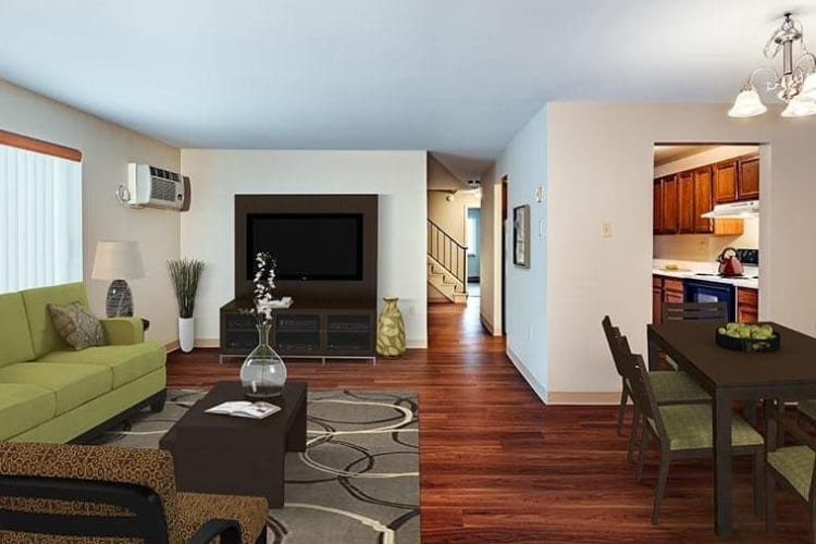 Spacious living room at Maiden Bridge & Canongate Apartments in Pittsburgh