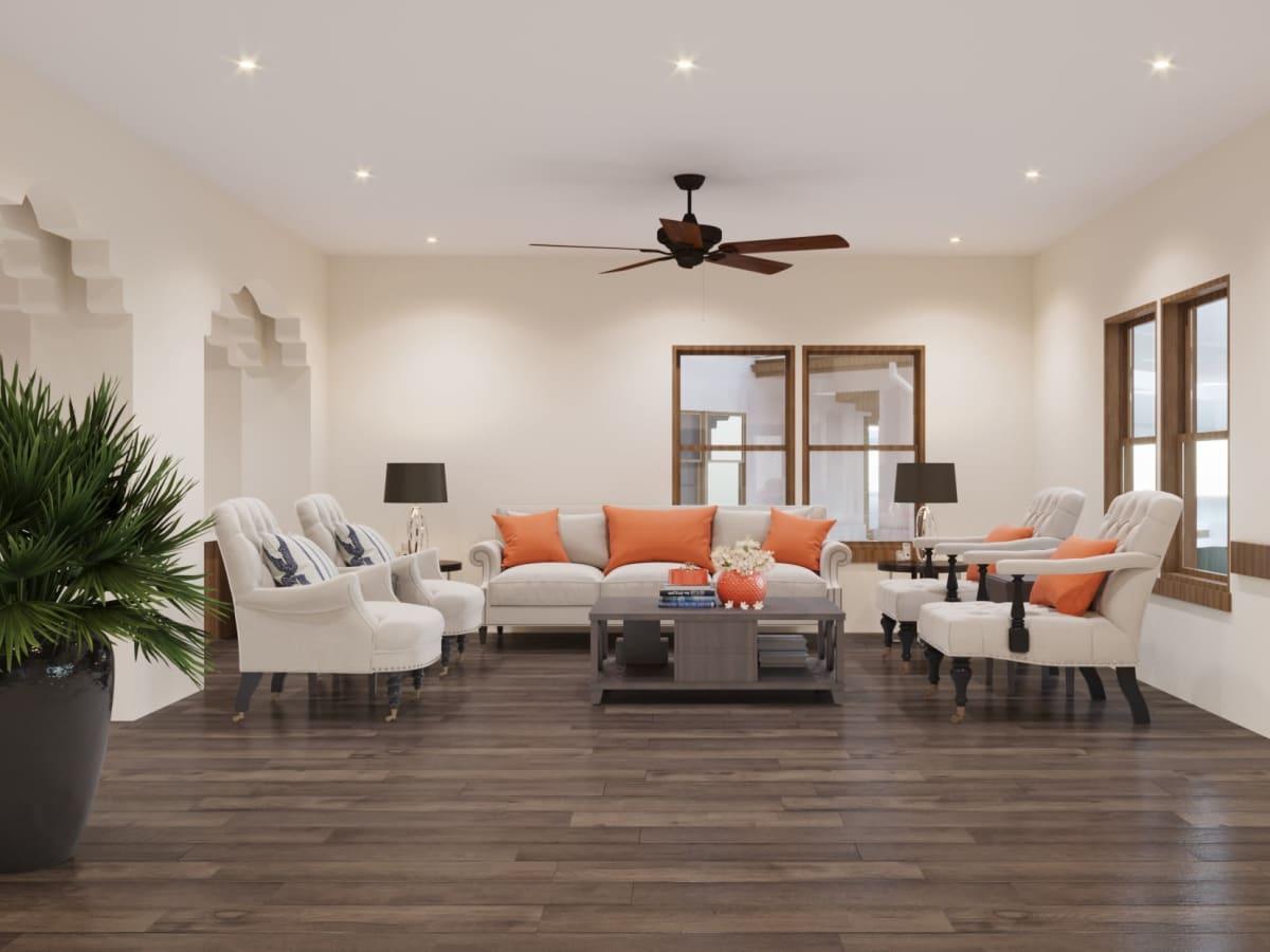 Open sun room with hardwood floor and couches at Ativo Senior Living of Sundance in Buckeye, Arizona