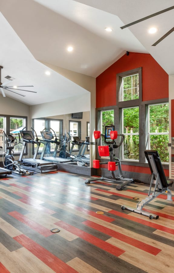 Newly Renovated Fitness Center with Large windows with a view of the pool area at Wildreed Apartments in Everett