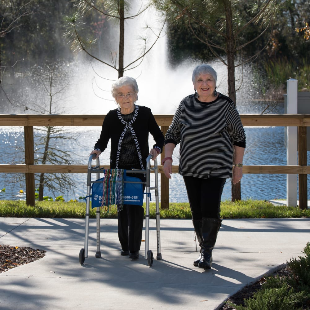 A resident couple out for a walk near an Inspired Living community.