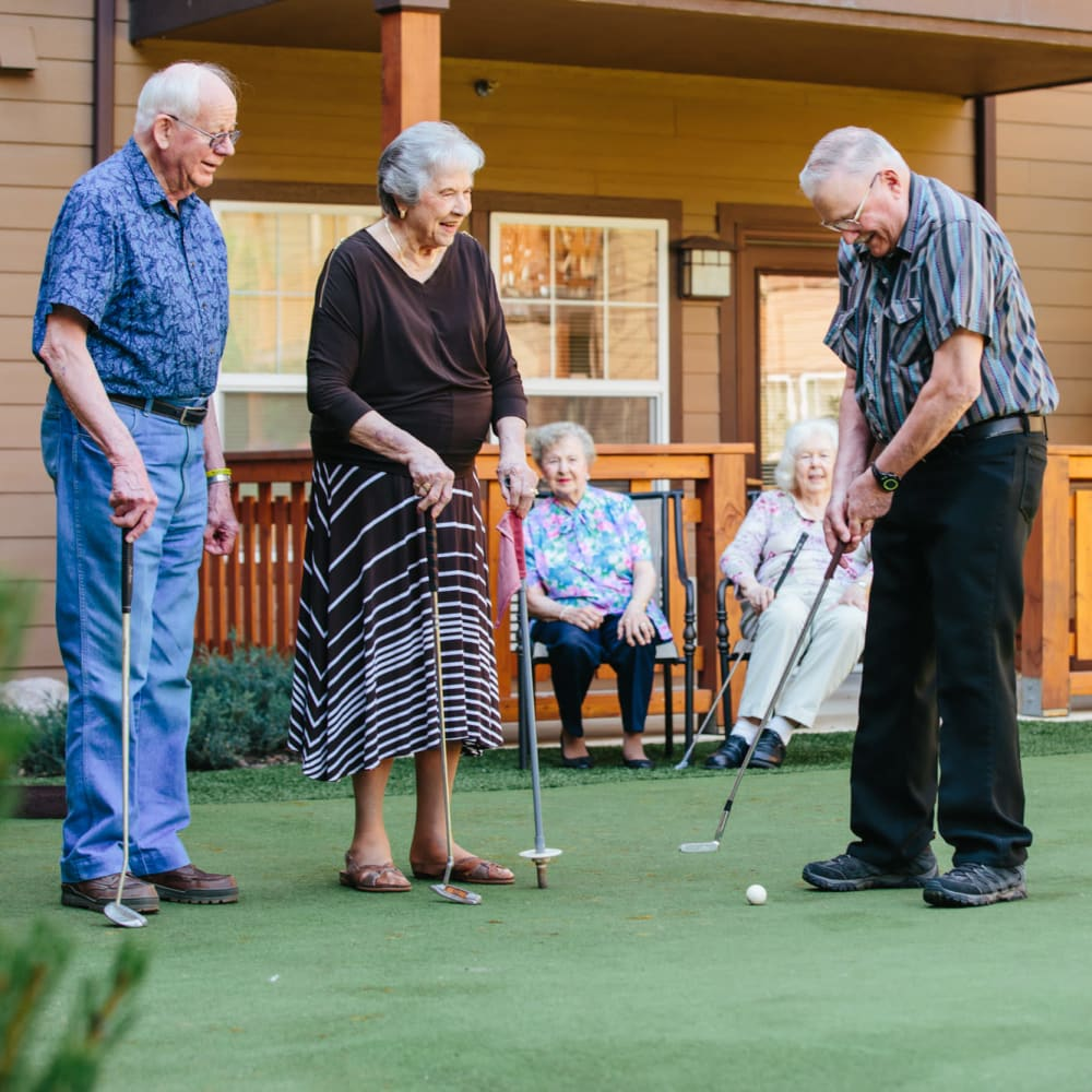 Residents playing mini golf at The Springs at Butte in Butte, Montana