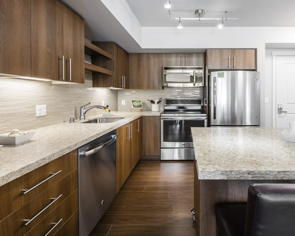 Kitchen with granite counters at The Meyden in Bellevue, Washington