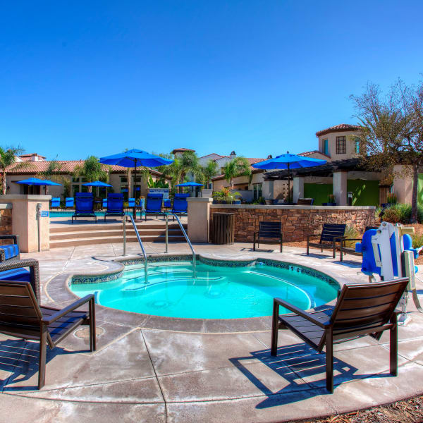Beautiful view of resort-style spa and bright blue sky at Palisades Sierra Del Oro in Corona