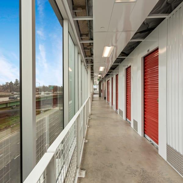 Indoor storage units with red doors at StorQuest Self Storage in Gardena, California