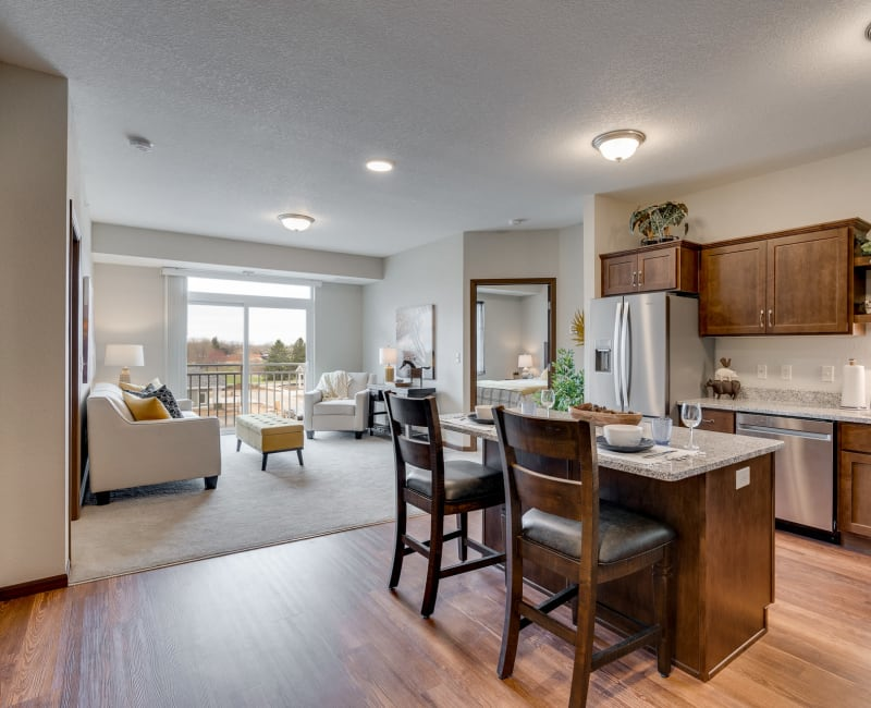 open floor plan of kitchen and living room apartment at The Fields at Arbor Glen in Lake Elmo, Minnesota