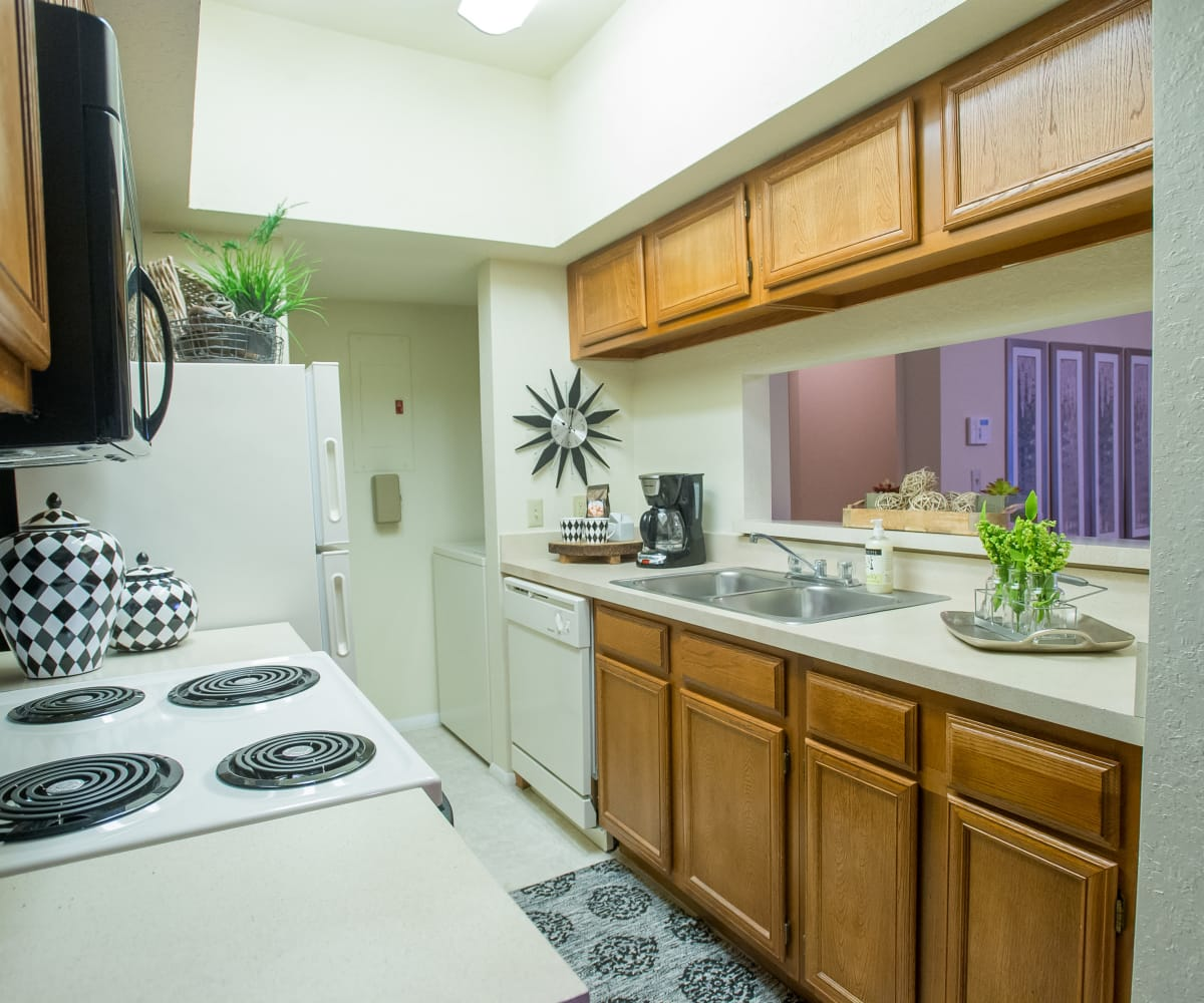 Kitchen with plenty of cabinet space at The Courtyards in Tulsa, Oklahoma